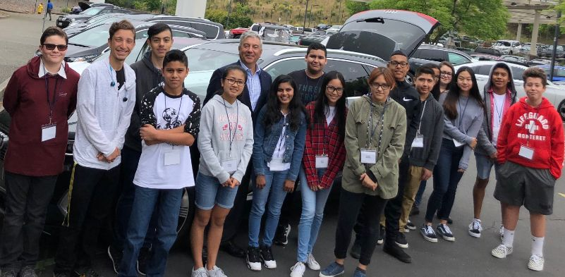 CEO Ron Nersesian shows his personal electric vehicle to MHA students.