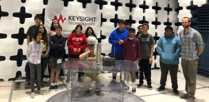 MHA students explore a Farraday cage on a tour of the Environmental Test Lab led by Keysight's David C. Gibbons