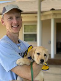 Keysight Chief Technology Officer, Jay Alexander, volunteering at Canine Companions for Independence, an organization that provides assistance dogs free of charge to enhance the lives of people with disabilities.