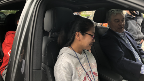 Keysight CEO, Ron Nersesian, goes hands-on with students during a STEM focused Mike Hauser Academy event hosted at Keysight headquarters, sharing a walkthrough of his personal electronic vehicle to showcase the related technologies as part of the student learning experience.